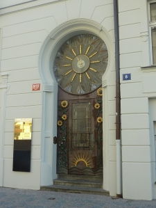 Door with sunflowers and clock